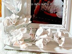 Create a floral frame that looks like Porcelain with dollar store flowers and plaster!  This unique and beautiful faux Porcelain frame makes a wonderful gift. […