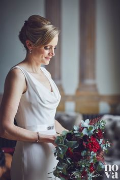 Our stunning Nicki with flowers by Poppys Flower Studio at #RockbeareManor in October