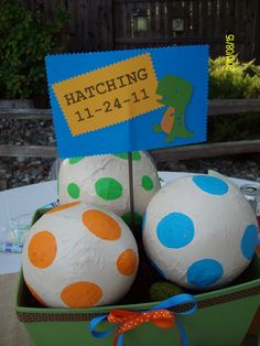 centerpieces for dino babyshower- dinosaur eggs! paper mache  popularwiththepoplins.blogspot.com