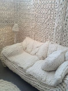 White Chunky Knit Sofa Slipcover, Hanging Wall, Shade, and Area Rug