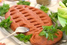 """Kibbe Nayyeh stands for """"raw Kibbe"""", Kibbe being the patties made from ground meat, burghul (cracked weat), herbs and spices."""