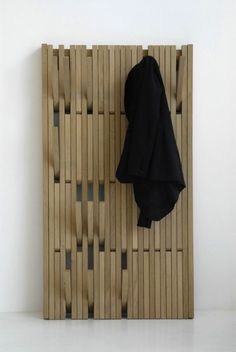 completely adjustable wooden wall coat rack / hanging wall panel. Patrick Seha