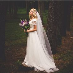 [Pretty gown, pretty woman, pretty photo.]  Love her bouquet