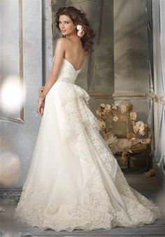 Jim Hjelm gown with floral cascade back and hem
