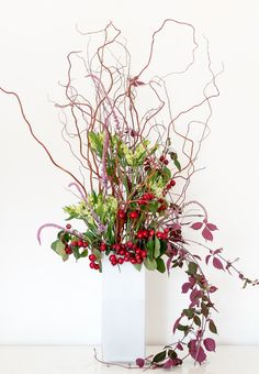 Wild corporate flowers - twisted willow, alstroemeria, crab apples. Corporate arrangement by Okishima & Simmonds Limited London www.okishimasimmonds.com