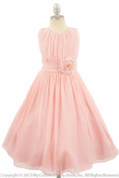 Blush Pink wrinkled chiffon flower girl dress, perfect to wear as part of the wedding party or even as a guest! Blush Pink is one of this season's hottest colors so you would definitely be making a fashion statement in this dress. The bodice is beautifully pleated and accentuated with a gathered waistband and detachable flower. This dress falls below the knee and is fully line with crinoline. Perfect flower girl dress for all summer occasions.