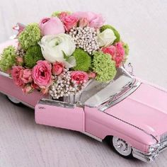 Pink Cadillac wedding center pieces would be so cute and different!!!