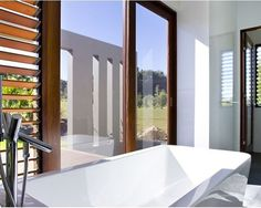 Charming Resort Design with Contemporary Look: Charming Bathroom Glass Window Near Bath Tub Pavilion House