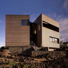 This wood-clad house perched on rocky terrain in Victoria, Australia, was designed by Australian practice Farnan Findlay Architects