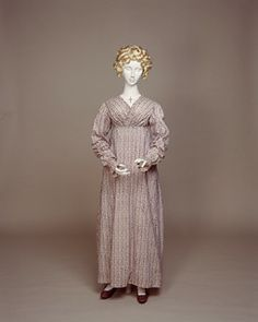 Day Dress: ca. 1815-1818, English, roller printed cotton, neck and overlapping fronts are edged with ruched frill, skirt is cut straight with two widths like a falling apron front, the sleeves are extremely long, bunching at the cuffs.