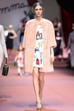 Dolce and Gabbana took the mommy and me theme to the max, showing both models big and little in the same look or often using children's drawings as prints and embroideries on sheaths and coats.