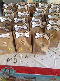 Paw Patrol Party Goody Bag idea I came up with. Super simple plus I saved a lot of money! The inside has a Paw Patrol cup ($1 at Dollar Tree) filled with candy also from Dollar Tree. I searched dog bone images from Google and just cut them out myself and stapled them to the front of the bag, punched holes thru the fold and sealed them shut with ribbon ( loop the ribbon thru the holes to tie a bow). The Paw Patrol stickers were also $1 for a pack of 3 sheet stickers.