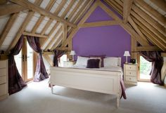 Oak frame bedroom built half into roof with exposed oak rafters