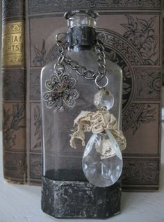 This is one of my original altered bottles. Antique bottle soldered with a vintage charm and antique chandelier crystal. Looks just spectacular with a small bouquet of flowers, sprigs of greens or a handfull of sweet smelling Altered Bottles, Antique Bottles, Vintage Bottles, Bottles And Jars, Glass Bottles, Perfume Bottles, Vintage Perfume, Antique Glass, Bottle Box
