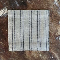 //fog Linen Tablecloth. From ANAISE · Image Of Coasters: Natural Blue Stripe