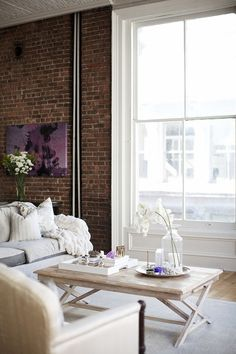 Love love this wall size window with the rustic loftish brick wall