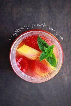 Sangria with white wine and vodka, raspberries and peaches!