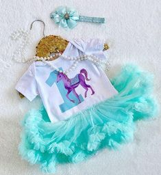 Unicorn ONE Tutu Dress Aqua Set - Ruffles & Bowties Bowtique The perfect way to celebrate the most magical of days! Our Unicorn ONE Tutu Dress makes for the very best of first birthday celebrations! Birthday Tutu, Birthday Dresses, Baby Fall Fashion, Fashion 2016, High Fashion, Fall Hats, Winter Hats, Princess Tutu Dresses, Knit Beanie Hat