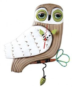 $59 Snow Owl Wall Clock with pine cone swinging pendulum. Hand painted original design by Michelle Allen. The leaves on the end of the branch are beaded wire and reflect light nicely, as does the white glitter on his face and wings. So sparkly. Do you have a woodland themed room for this guy to roost in? Are you a Hedwig fan? #quirksofart