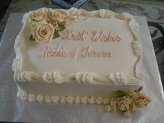 sheet cake for a small family wedding dinner. Last minute order so I used some pre-made flowers and colored them