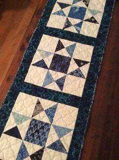 A personal favorite from my Etsy shop https://www.etsy.com/listing/495889070/quilted-winter-ohio-star-table-runner