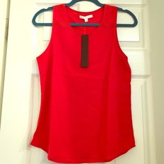 BNWT Aryn K Red Top BNWT Aryn K Red sleeveless Top. Size small. 97% polyester, 3% spandex. Aryn K Tops Tank Tops
