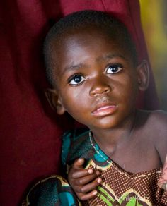 Uganda...how can you not love this precious child?