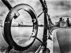 """A Day at the 'O'pera, House. - This fisheye composite of 5 bracketed shots assembled by hand (not via luminosity masks) and then converted to black and white, allows for a long view of the fenceline and city skyline impossible with regular lens optics.  <a href=""""http://Linz550.500px.com"""">Portfolio</a> 