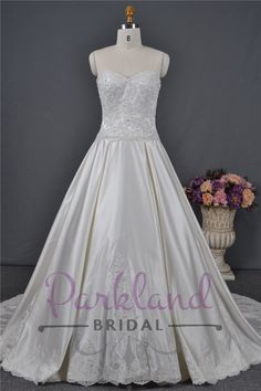 http://www.parklandbridal.co.nz/Store/tabid/4393/ProdID/33803/CatID/358/Parkland_Bridal_Aurora.aspx  A beautiful strapless gown with a heavily beaded lace bodice and lace edging on the train. Dress has been made in luxury satin - DIVINE!
