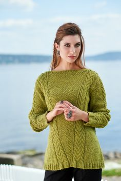 Sand Cables that travel from the center towards each shoulder dominate this fitted sweater with a rounded boat neck. The center panel of double seed stitch is framed and increases in size with the cable move. On the long sleeves the cables dominate. Named after the most powerful spirit Shalana.