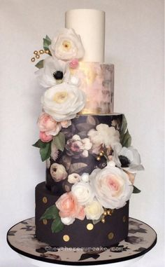 I created this cake for the San Diego cake show. I was very pleased that it was awarded best in show. All handmade wafer paper flowers and leaves. The flowers are a combination of my wired and non wired methods. Second tier is hand painted with my...