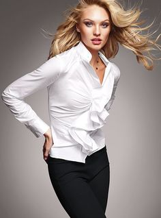 Shirt    The classic shirt plays dress-up—and zip-up. Front and back darts combine for a fitted, figure-framing silhouette. Pretty little touches include a mandarin collar and a button at the sleeve.