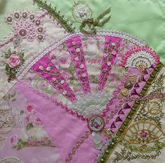 I ❤ crazy quilting . . . Wendy's block-  for the CQI Anything Goes round robin. The bottom right corner is done by Gerry K, the central fan by Ati and the upper left by me.  ivoryblushroses