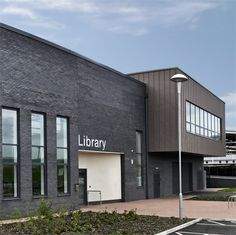 Hattersley Hub, John McCall Architects. Library entrance, cantilevered form
