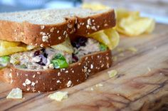 When I was growing we would always put chips on our bologna sandwich 'cause it made the meat go farther. But here's a good combination with tuna fish. I'm always a fan of a cool sandwich, especiall...