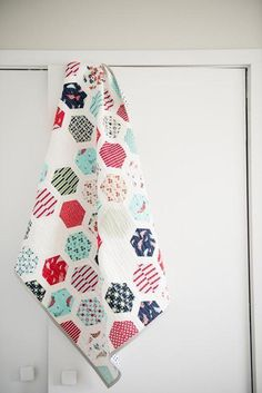 """Hexie Framed   Craftsy. Quiltylove.com. This fun and modern quilt pattern shows off your favorites print fabrics. This pattern is ideal for a jelly roll since it uses 2.5"""" strips. You can substitute fabric from your stash or fat quarters or fat ei"""