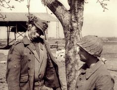 American GI meets young German hanged by the SS for leaving his post only a few days before the fall of Berlin, April 1945.