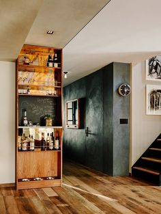 In this Brooklyn home, smart built-in storage pieces lend themselves to double-duty performance, like this wet bar with integrated chalkboard and dog bowls.