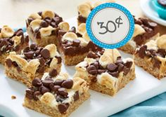 Chocolate Marshmallow Magic Bars- A chocolatey marshmallow topping makes these bars so melt-in-your-mouth good, they ll disappear like magic at home or any bake sale. Chocolate Toffee Bars, Chocolate Chip Blondies, Chocolate Oatmeal, Chocolate Marshmallows, Chocolate Chip Recipes, Chocolate Marshmallow Squares, Apple Recipes, Baking Recipes, Milk Recipes