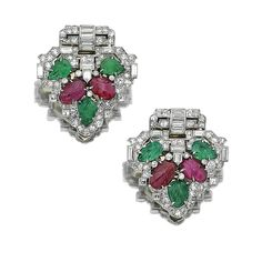 Pair of emerald, ruby and diamond clips, Mauboussin, circa 1930 - Each of stylised shield design, set with carved emerald and ruby leafs, circular-, single- and square-cut, shield-shaped and baguette diamonds