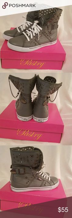 Sugar Rush Pastry High Tops Women Size 8.5  Sugar Rush Pastry High Tops Women Size 8.5. Condition 9/10 only because they've been worn they are in mint condition. They are Grey on Grey. You can wear them several different ways the choices are countless. I love these shoes just too big for me. I never found my size and bought these because I liked them so much but only wore them once. I've had them since 2014. Someone some where is looking for these. Comes with original box. Pastry Shoes…