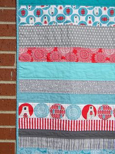 Nothing wrong with strips! Easy and quick way to quilt. Plus, it's perfect for those novelty fabrics you can't bear to chop up. Brrr! Baby Quilt, via Flickr.