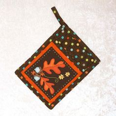 It's All about Fall with this warm and wonderful autumn leaves potholder from Green Acorn Kitchen. #potholder #hotpad #autumndecorations #fall #handmade
