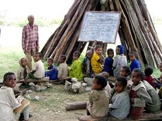An outdoor classroom in rural India, where teacher absentism rates create problems for learning.