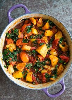 Roasted Root Vegetables with Tomatoes and Kale! A ragout of roasted root vegetables—parsnips, carrots, beets, rutabagas—with tomatoes and kale On SimplyRecipes.com #glutenfree #paleo #vegan