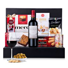 Our elegant new gourmet gift basket offers a rich array of fine European foods paired with a lovely French red wine. A sophisticated gourmet gift idea for corporate gifting, Christmas, birthdays, and to delight the