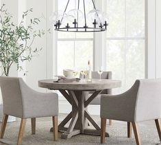 Classic Slope Upholstered Dining Armchair #potterybarn Round Pedestal Dining Table, Dining Arm Chair, Extendable Dining Table, Upholstered Dining Chairs, Table And Chairs, Side Chairs, Dining Room, Round Chandelier, Pottery Barn