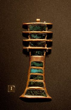 Djed Pillar Amulet from the tomb of Tutankhamun. It represents stability. The djed pillar is associated with Osiris, the Egyptian god of the afterlife, the underworld, and the dead. It is commonly understood to represent his spine.