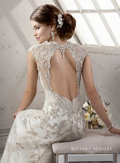 Bold metallic embroidered floral lace wedding dress with gorgeous open back. Clementine by Sottero and Midgley.