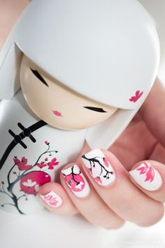 Are you a fan of kimmidolls? These are popular dolls which have been derived from the Japanese kokeshi dolls. This kimmidoll inspired nail art design is perfect for enthusiasts as well as those who like the simple combination of pink and white and of Japanese culture embedded unto their nails.